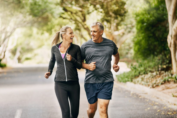 Shot of a mature couple out jogging on a sunny day